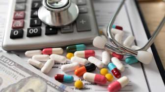 Photo illustration of money and pills