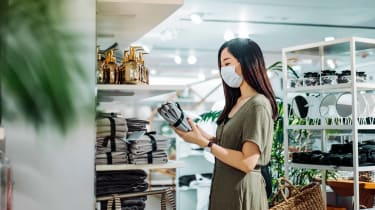 An Asian woman shopping in a home goods store