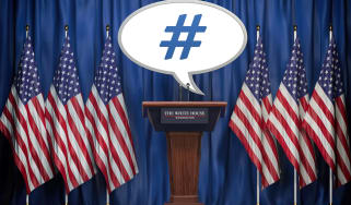 "Photo illustration shows a podium surrounded by U.S. flags with a speech bubble the reads ""#."""