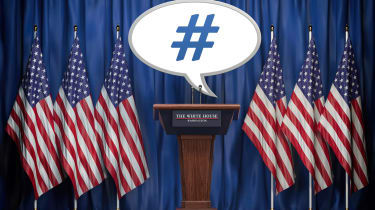 """Photo illustration shows a podium surrounded by U.S. flags with a speech bubble the reads """"#."""""""