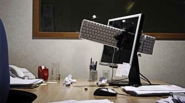 A keyboard is thrown through a monitor
