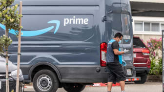 An Amazon Prime delivery driver wearing personal protective equipment delivers packages during the shelter in place order and quarantine.