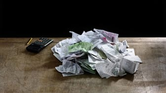 pile of receipts on table