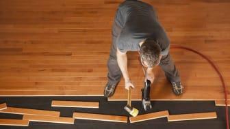 Contractor installing hardwood flooring