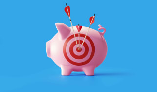 photo of a piggy bank with a target on its side and arrows