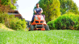 Landscaper on riding mower