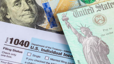 picture of tax form, government check, and a one hundred dollar bill