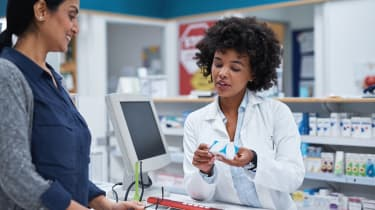 Shot of a pharmacist assisting a customer in a chemist
