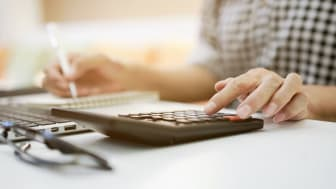 A person uses a calculator
