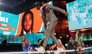 Jaylen Waddle walks onstage after being selected with the sixth pick by the Miami Dolphins during round one of the 2021 NFL Draft on April 29, 2021 in Cleveland,.