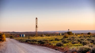 Drilling Fracking Rig in the Southwest desert at sunset