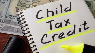 """picture of a notebook with """"child tax credit"""" written on a page"""