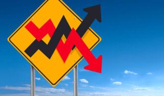 A caution sign with up and down stock arrows