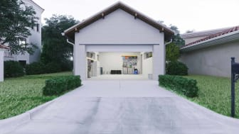Open door of a modern garage with a concrete driveway