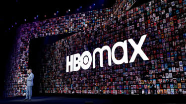 An HBO Max sign is shown in the background during an AT&T investor presentation