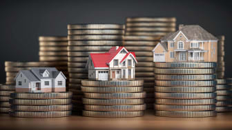 tiny houses on stacks on coins