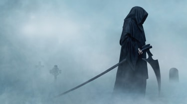 Grim Reaper in a fog-covered cemetery
