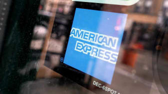 CHICAGO, ILLINOIS - JANUARY 24: A sticker pasted at the entrance of a business lets customers know that they accept American Express credit cards on January 24, 2020 in Chicago, Illinois. Ame