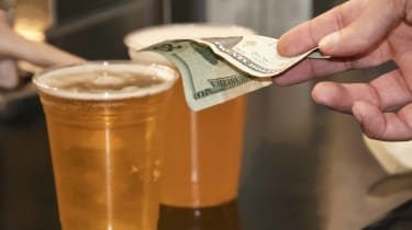 picture of person paying for beer