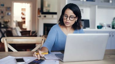 picture of woman working on her taxes at her computer