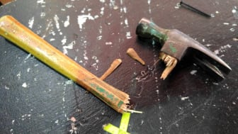 Close-Up Of Broken Hammer Handle On Table