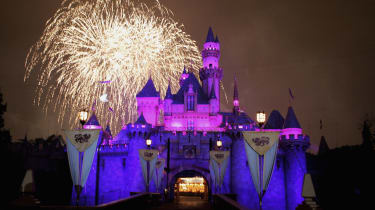 "ANAHEIM, CA - MAY 4:Fireworks explode over The Sleeping Beauty Castle as part of the Disney Premiere of ""Remember...Dreams Come True"" the biggest firework display in Disneylands history durin"