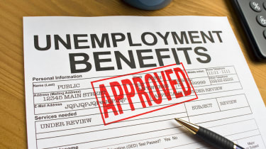 Approved Unemployment benefits application on a desktop. Application is approved and stamped with a RED approved.