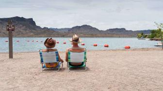 Couple sitting on deck chairs, Lake Havasu, Arizona