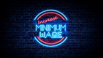 """picture of neon sign saying """"increase minimum wage"""""""