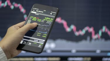 picture of person checking stocks on a phone
