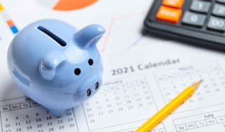 Picture of piggy bank with calendar background