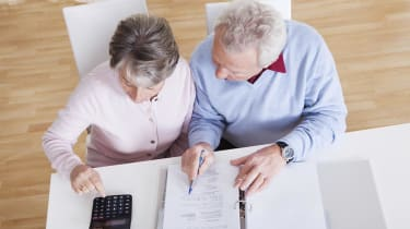 Senior Couple Calculating Budget