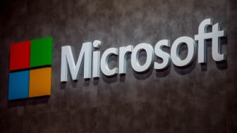 BARCELONA, SPAIN - FEBRUARY 22:A logo sits illuminated outside the Microsoft pavilion on the opening day of the World Mobile Congress at the Fira Gran Via Complex on February 22, 2016 in Barc