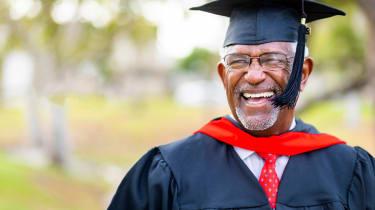 A senior man graduates with his master's degree
