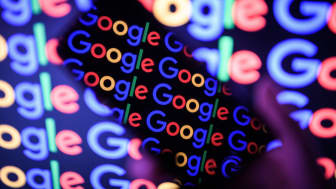 LONDON, ENGLAND - AUGUST 09:In this photo illustration,The Google logo is displayed on a mobile phone and computer monitor on August 09, 2017 in London, England. Founded in 1995 by Sergey Bri