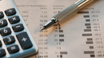 picture of calculator sitting on a financial report for bonds