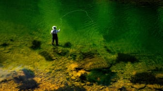 A lone fisherman seen from above fly fishing in Alabama