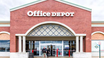 Sterling, USA - April 4, 2018: Office Depot store in Fairfax county, Virginia shop exterior entrance with sign, logo, doors , couple walking out