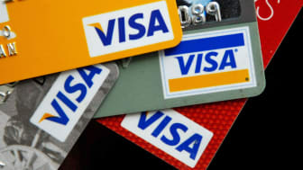 SAN FRANCISCO - FEBRUARY 25:Visa credit cards are arranged on a desk February 25, 2008 in San Francisco, California. Visa Inc. is hoping that its initial public offering could raise up to $19