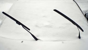 Car with wipers up in snow