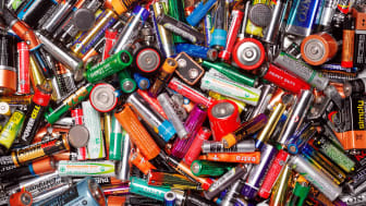 A pile of household batteries of various sizes