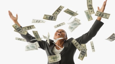 picture of happy woman holding hands in the air as money falls from the sky