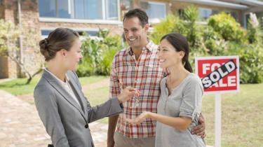 Realtor giving couple keys to new house