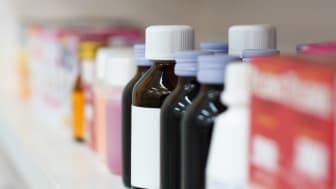 Close up medicine bottles in the pharmacy shelves