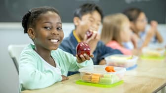 student eating lunch out of tupperware container