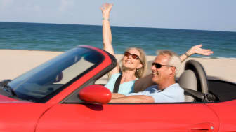 Senior couple driving on Florida beach