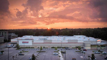Aerial shot of a Costco warehouse store at sunset