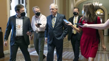 Senate Minority Leader Mitch McConnell (R-Ky.) walks to his office at the U.S. Capitol on Oct. 06, 2021, in Washington, D.C.