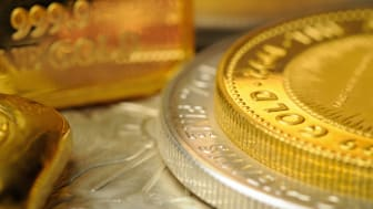 """""""A collection of gold and silver coins and bullion. The words Gold, 999.9 Fine Gold and Fine Silver can be seen."""""""