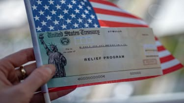 picture of relief program check and American flag
